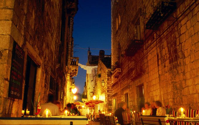 Dusk cafe scene in the streets of old Dubrovnik.