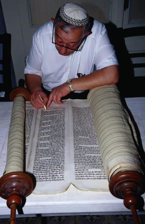 Rabbi restoring a 300 year old Torah. The Torah is a sacred Judaic scripture- Izmir, Izmir province, Turkey