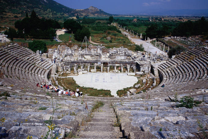 The Great Theatre at Ephesus. Completed by the Romans in 117 AD, the theatre is still used for performances today. Leading out from behind the theatre is Harbour Street- Ephesus, Izmir province, Turkey