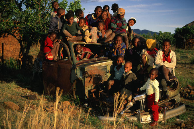 An overland trek that didn't quite make it, children from the village of Malealea make good use of an abandoned truck