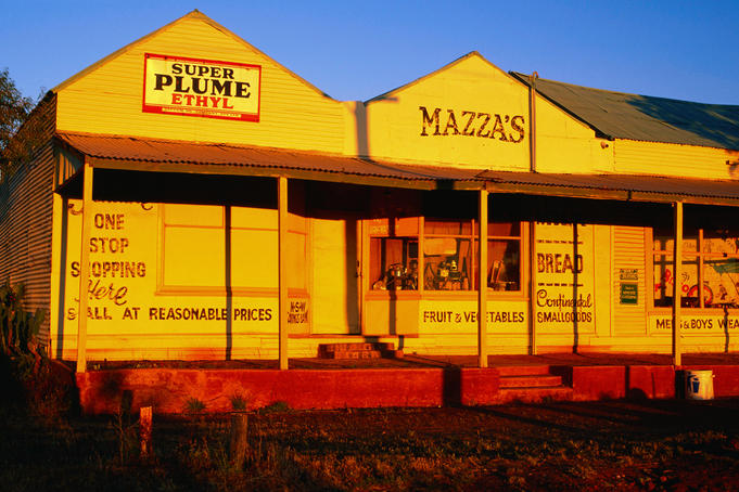 Goldfields region: Late afternoon adds a golden hue to the front of Mazza's store, an historic building, now restored, at the old Gwalia town site near the town of Leonora - Gwalia, Western Australia