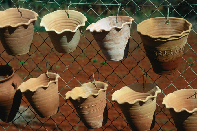 Local pottery ware hanging on a fence - Ibiza Island, Balearic Islands