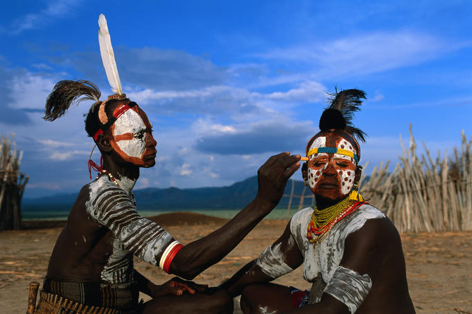 Two Karo people with elaborate body painting from the Kolcho village.
