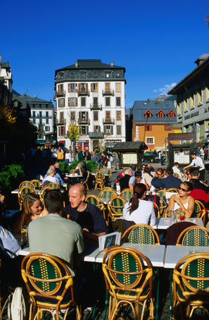 Outdoor dining in sunshine on main square of Place Balmat.