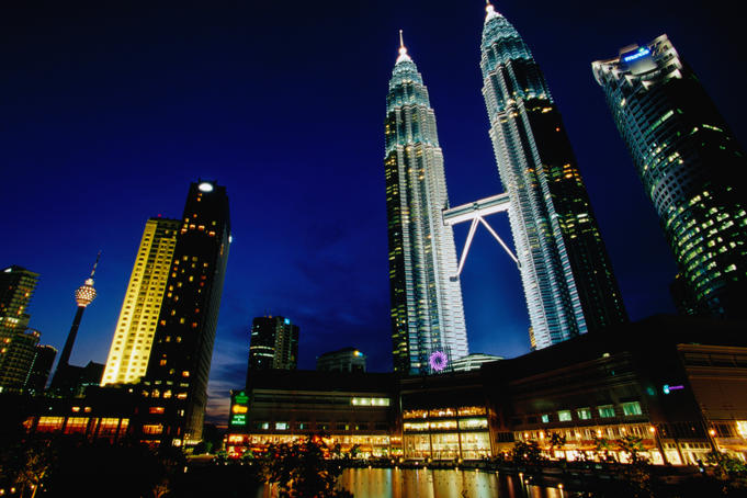Petronas Towers in night city skyline.