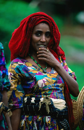 A local woman takes a break from tea picking near the town of Gore, Ilubabor