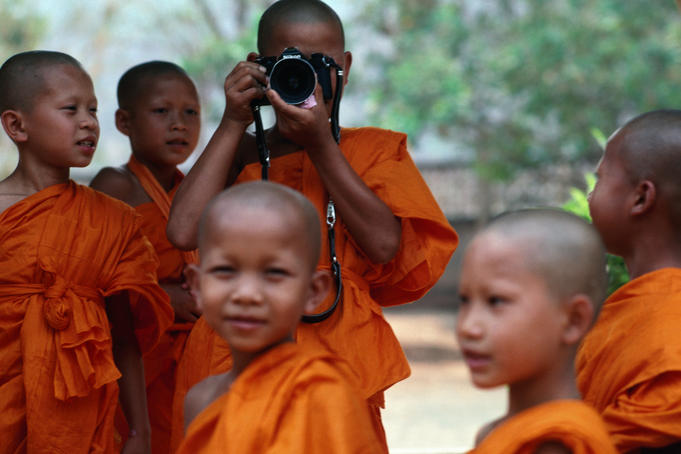 Novice monks learning workings of camera.