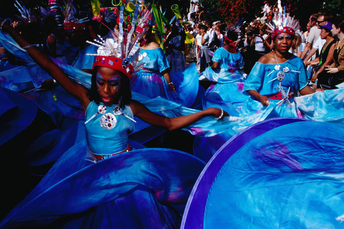 People in costume dancing at Notting Hill Gates annual carnival.