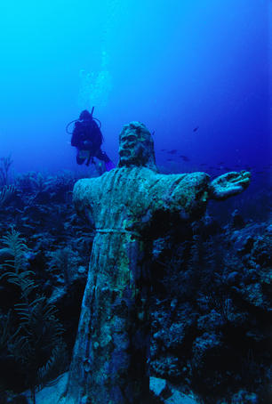 Statue of Christ on reef underwater.