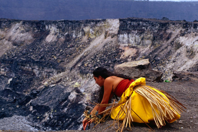 A local woman placing offerings to the Fire Goddess, Pele, during a ceremony at the Halemaumau Crater.