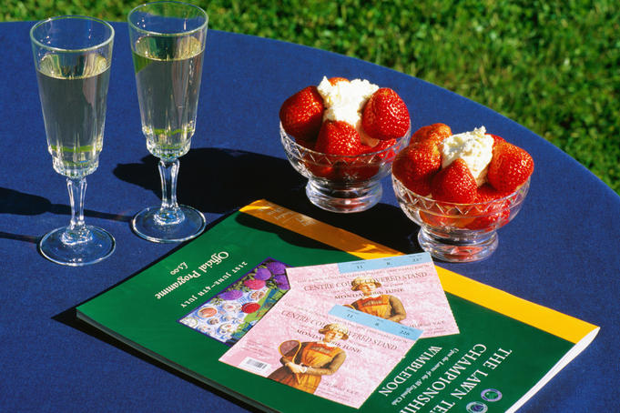 Champagne, strawbwerries and cream, tickets and programme of Wimbledon Tennis Championship.