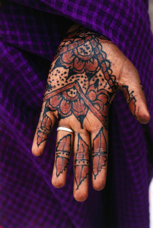 Henna hand tattooes are thought to enhance the beauty and are often applied to palms and feet on special occasions - Djibouti