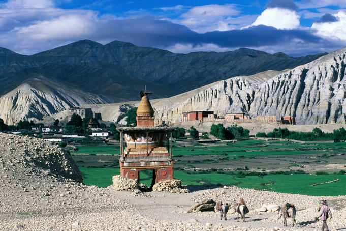 Stupa, fertile valley and barren mountains.