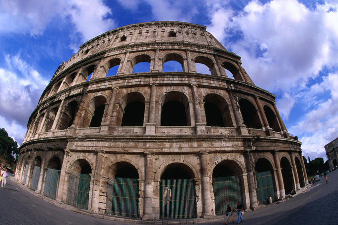 The Colosseum or Flavian Amphitheatre of Rome. The building was  begun by Vespasian, inaugurated by Titus in 80 AD and completed by  Domitian.