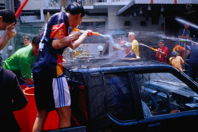 Spraying water water pistols to celebrate Thai New Year during Songkhran Festival.