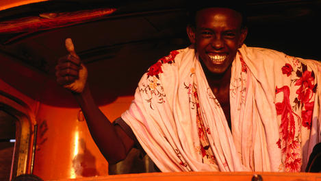 Smiling man inside truck, Somaliland, Puntland &amp; Somalia