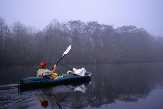 Kayaking through the misty Withlacoochee River Springs, taking care not to wake any alligators