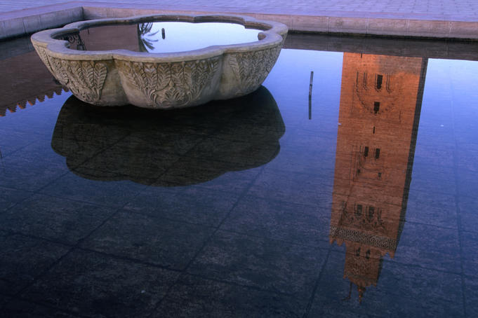 12th century Koutoubia minaret (70m) reflected in a fountain.