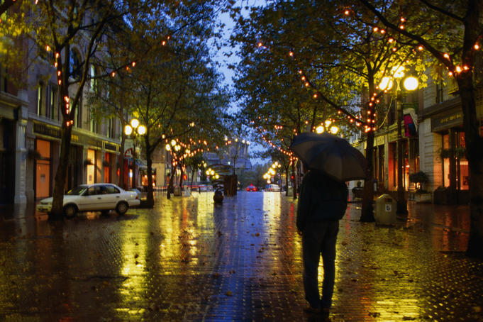 Lone figure on rainy evening in Occidental Square.