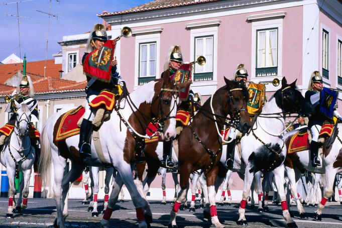 Guards of National Palace riding horses during ceremonial parade.