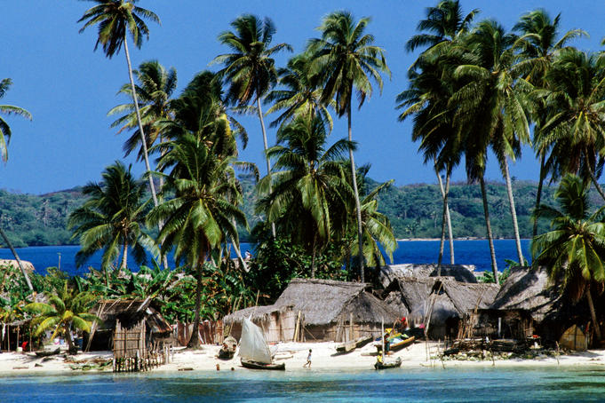 Tropical island village on beach.