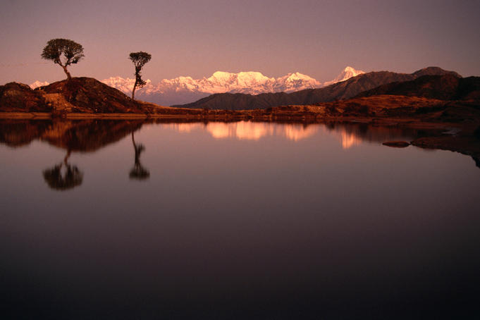 Sunrise view of lake at Gupa Pokhari with Makalu Himal in background.