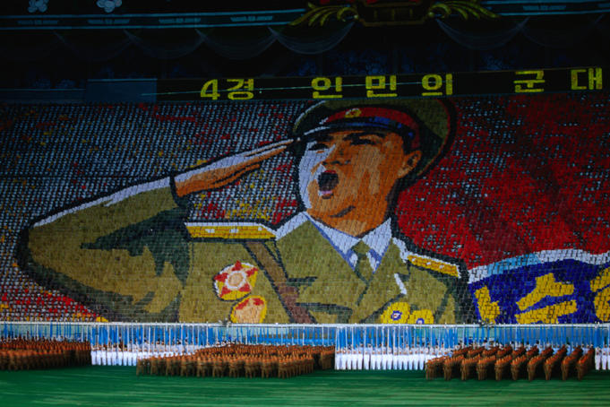 North Korean army officer leads out the dancing army during the Arirang Mass Games in Pyongyang.