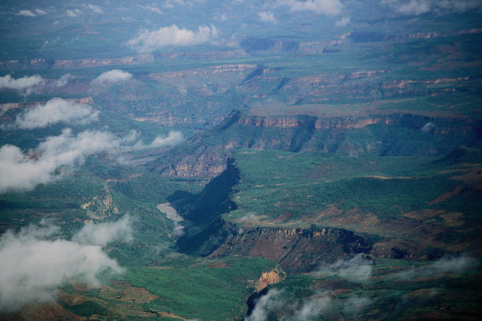 Clouds hover over the mile-deep Blue Nile Gorge, viewed from half way up the southern escarpment