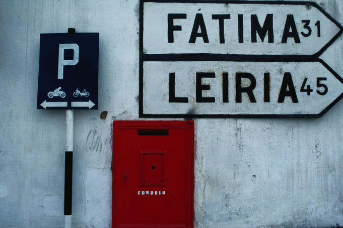 Street signs and letterbox in Tomar.