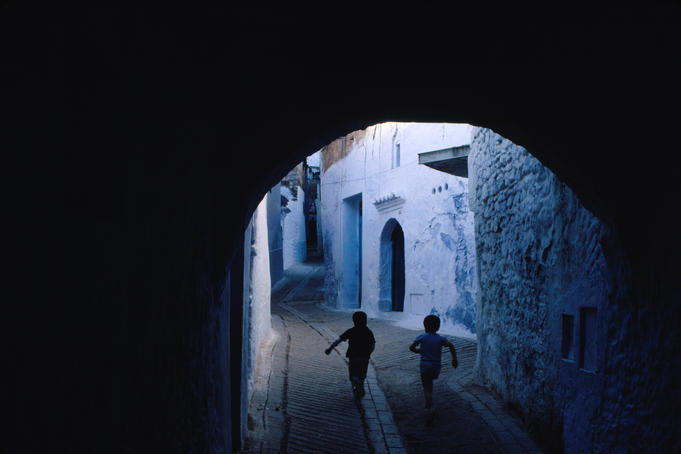 Two boys running through Kasbah, Chefchaouen