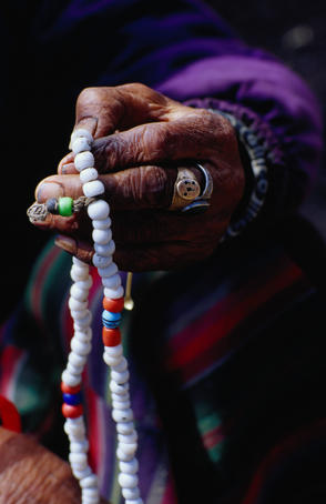 Loba nomad counting prayer beads.