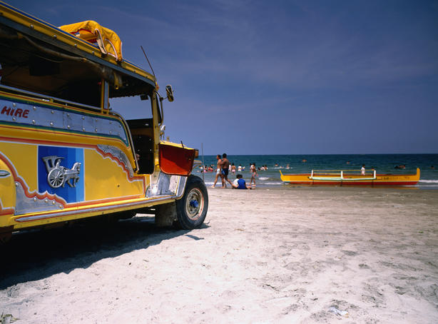 Yellow Jeepney on the beach.