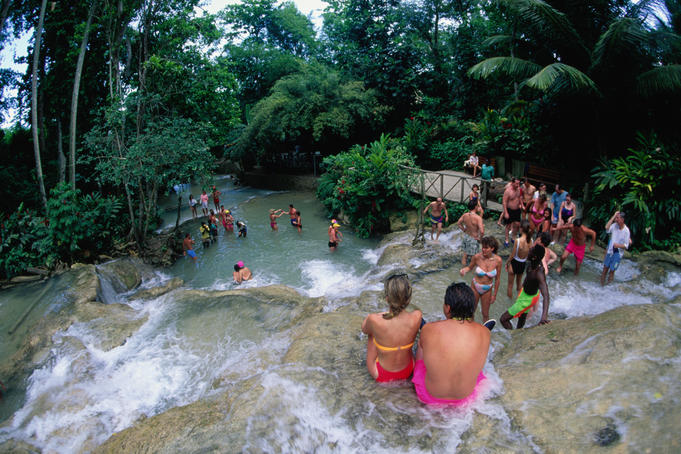People enjoying the cascading waters of Dunn's River Falls.