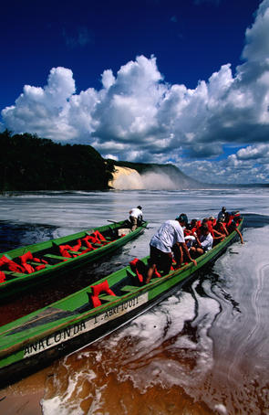 Tourists head out to the Lost World waterfalls in Canaima National Park.