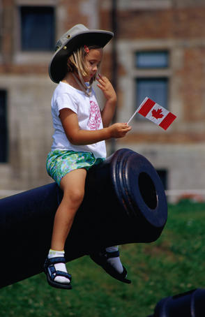 A small girl finds better use for an antique cannon in Quebec.