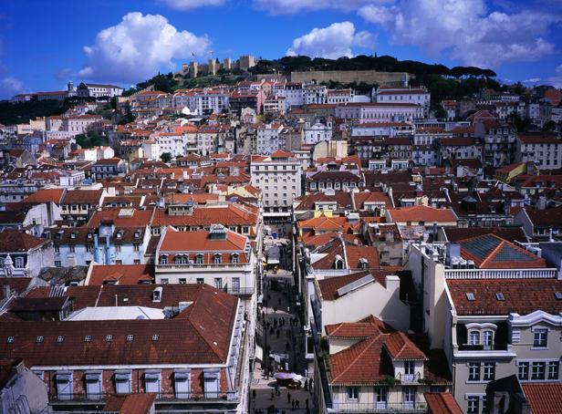 Overhead of rooftops of Baixa with Castelo de Sao Jorge in the distance.