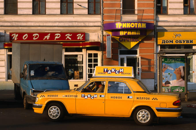 New yellow taxi in the street.