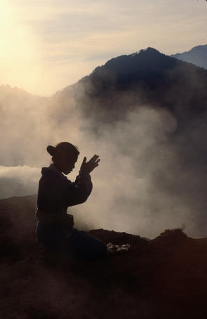 Woman leaving an offering on Mt Batur.