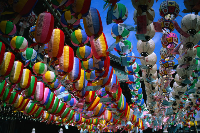 Strings of colourful paper lanterns suspended outside temple.