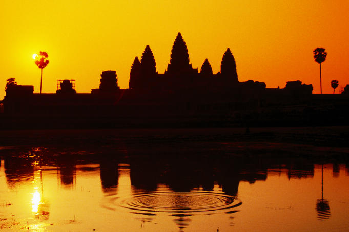 Sunrise over temple and sacred pond, Angkor Wat.