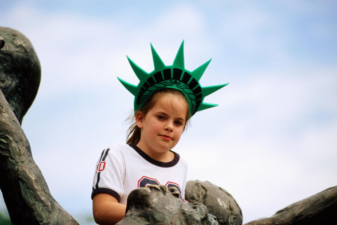 Portrait of girl with Statue of Liberty crown.