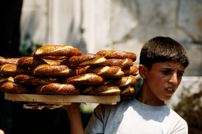 Boy selling pretzels.