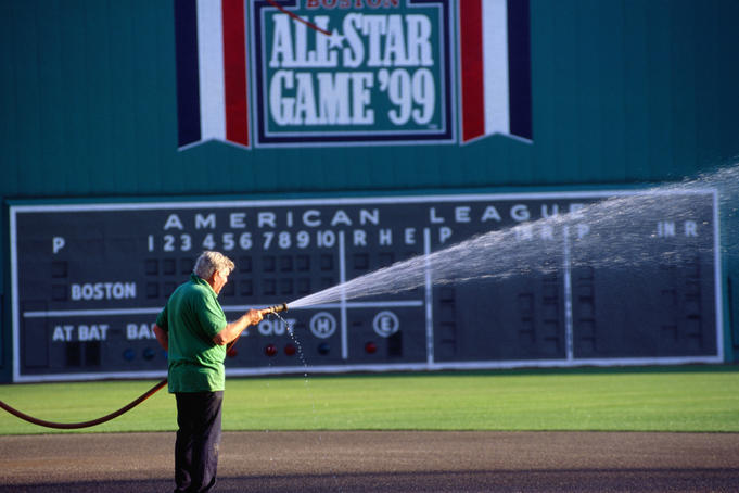 Groundskeeper tending Fenway Park in Boston.