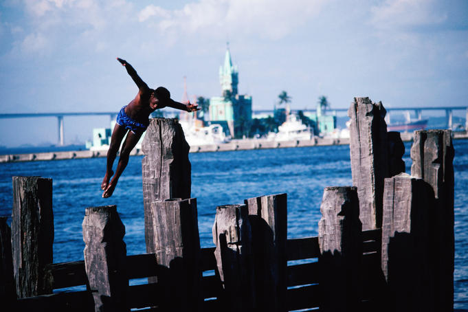 Man diving from pier.