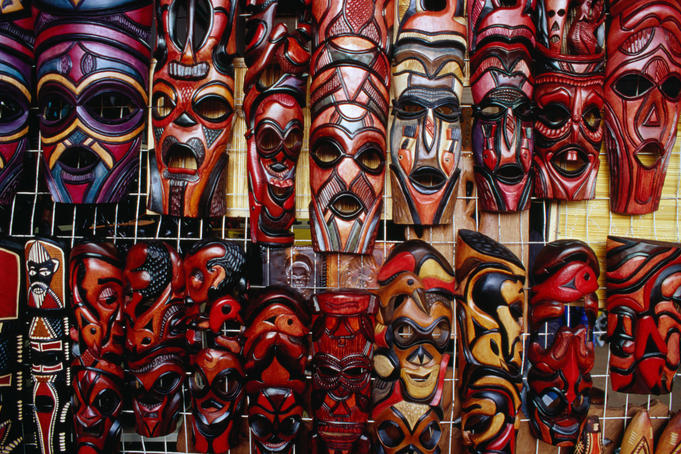 Craft for sale: carved wooden masks at a souvenir stall at Bruma Market World