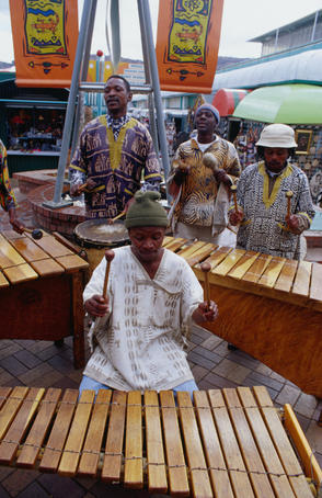 Musicians performing on wooden xylophones at Bruma Market World