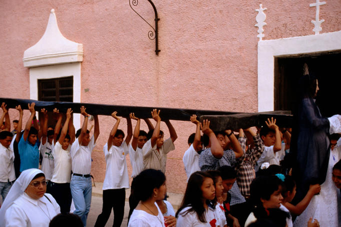 Men carrying cross, Semana Santa procession.