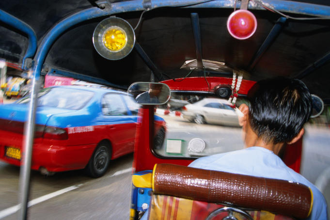 In the back of a tuk-tuk taxi.