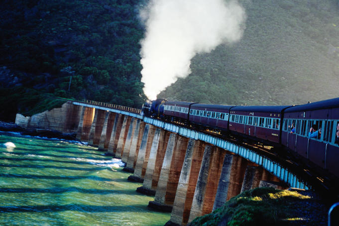 Outeniqua Choo-Tjoe steam train on bridge.