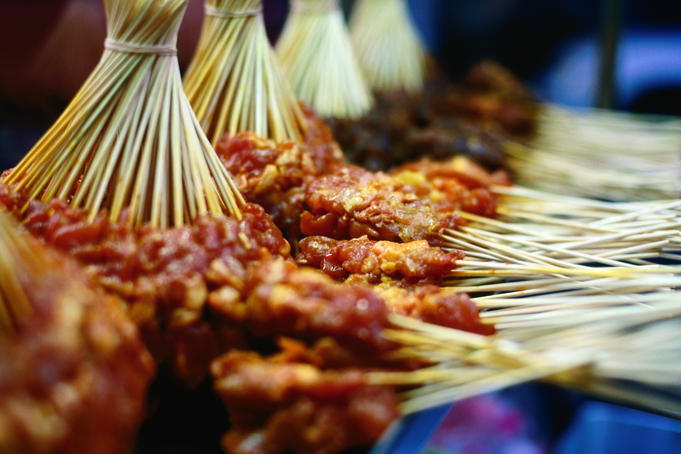 Uncooked satay at evening stall.